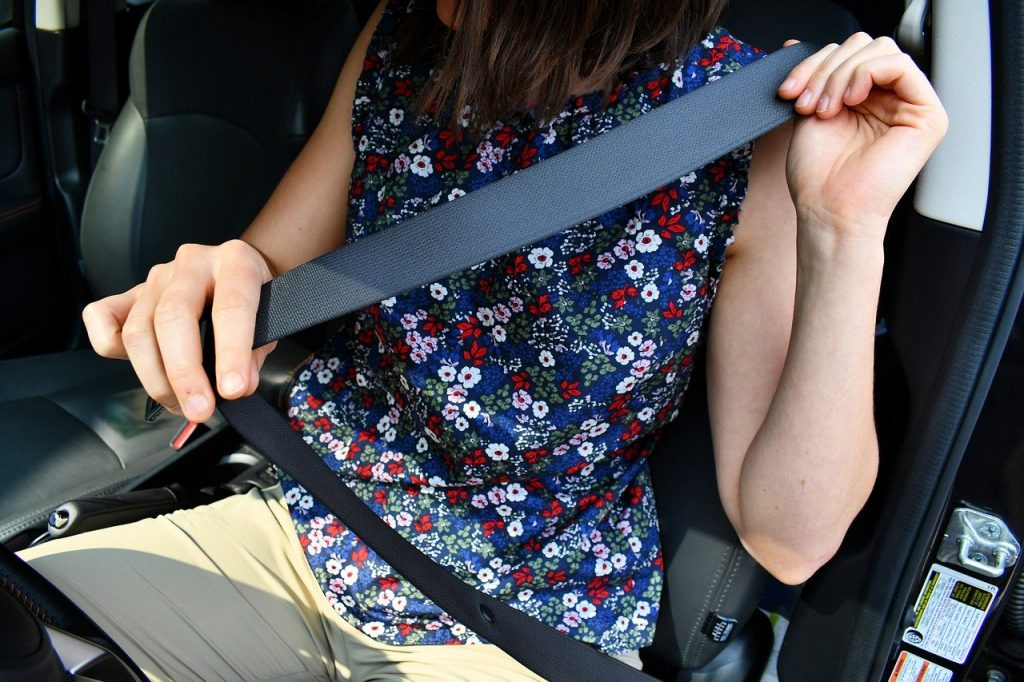 Woman Buckling Up Her Seat belt