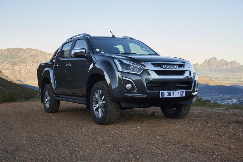 Isuzu D-Max Grey Parked On Gravel With Mountain Background